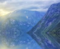Beautiful and dramatic Norway landscape with mountains and sea in fjord Stock Image