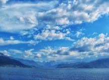 Beautiful and dramatic Norway landscape with mountains and sea in fjord Royalty Free Stock Images
