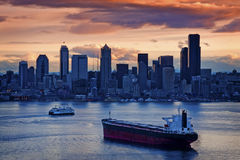 Seattle Sunrise. A beautiful and dramatic Seattle sunrise overlooking Elliott Bay with a ferry boat and a freighter in the foreground Royalty Free Stock Photo