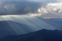 Beautiful dramatic sky with sun rays. over mountain Royalty Free Stock Photos