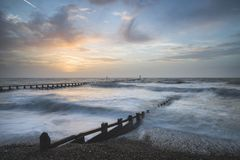 Beautiful dramatic stormy landscape image of waves crashing onto Stock Images