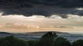 Beautiful dramatic Summer sunset landscape over English countrys. Beautiful moody Summer sunset landscape over English countryside with lovely light Stock Photos