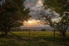 Beautiful dramatic Summer sunset landscape over English countrys. Beautiful moody Summer sunset landscape over English countryside with lovely light Stock Photo