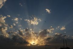 Dramatic Sunrise and Sunset in cloudy sky, Nature background with strong sunbeam, Hope concept. Beautiful and Dramatic Sunrise and Sunset in cloudy sky, Nature royalty free stock photo