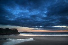 Beautiful dramatic sunset landscape over Rhosilli Bay beach Stock Image