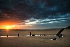 Beautiful dramatic sunset landscape over shipwreck on Rhosilli B Stock Image
