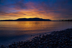 Sunset Over rcas Island. A beautiful and dramatic sunset over Orcas Island in the San Juan Islands of Puget Sound located in western Washington State. Taken from Royalty Free Stock Photo