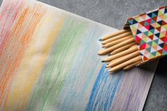 Beautiful drawing of rainbow and color pencils. On grey background Royalty Free Stock Image