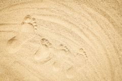 Beautiful drawing on the sand of the sea background. A Beautiful drawing on the sand of the sea background royalty free stock photography