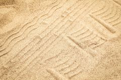 Beautiful drawing on the sand of the sea background. A Beautiful drawing on the sand of the sea background royalty free stock photos