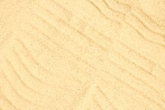Beautiful drawing on the sand of the sea background. A Beautiful drawing on the sand of the sea background royalty free stock photo