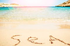Beautiful drawing on the sand of the sea background. A Beautiful drawing on the sand of the sea background stock image