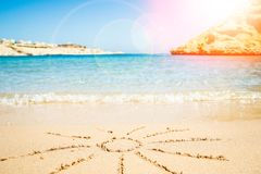 Beautiful drawing on the sand of the sea background. A Beautiful drawing on the sand of the sea background royalty free stock images