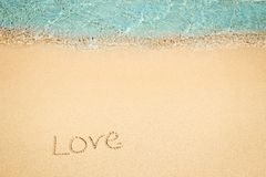 Beautiful drawing on the sand of the sea background. A Beautiful drawing on the sand of the sea background stock images
