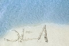 Beautiful drawing on the sand of the sea background. A Beautiful drawing on the sand of the sea background stock photo