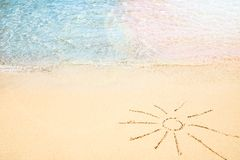 Beautiful drawing on the sand of the sea background. A Beautiful drawing on the sand of the sea background stock photography