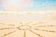 Beautiful drawing on the sand of the sea background. A Beautiful drawing on the sand of the sea background royalty free stock image