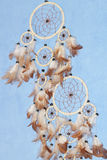 A beautiful dreamcatcher. A american dreamcatcher on a blue background Stock Photo