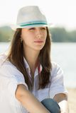 Beautiful dreaming girl at the beach. Stock Photography