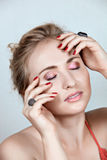 Beautiful dreaming woman. Beautiful woman dreaming with hands on her face: eyes closed, not isolated Royalty Free Stock Photos