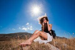 Beautiful dreamy curly woman in mountains Royalty Free Stock Photos