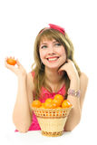 Beautiful dreamy girl with tangerines Stock Photography