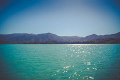 Beautiful dreamy ocean landscape with soft green hills of Abel Tasman Stock Photography