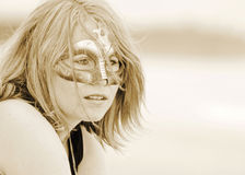 Beautiful dreamy portrait young pretty woman in mask sepia Royalty Free Stock Images