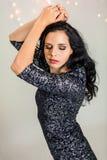 Beautiful dreamy woman with glitter dress dancing Stock Photo