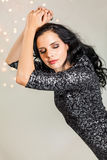 Beautiful dreamy woman with glitter dress dancing Stock Photos