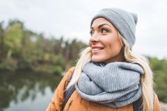 Beautiful dreamy woman. Portrait of beautiful dreamy woman in hat and scarf looking away Stock Photos
