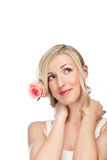 Beautiful dreamy woman with a rose in her hair Royalty Free Stock Photography