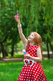 Beautiful dress girl with soap bubbles Royalty Free Stock Images