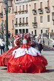 Beautiful dressed women in traditional Venetian costume, Venice, Italy Royalty Free Stock Photo