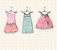 Beautiful dresses. Fashionable beautiful clothes for little girls Royalty Free Stock Photos