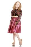 Beautiful dressy blonde girl in satin dress Stock Images