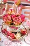 Beautiful dried roses in porcelain teacup Royalty Free Stock Images