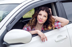Beautiful driver woman smiling  looking Stock Photo