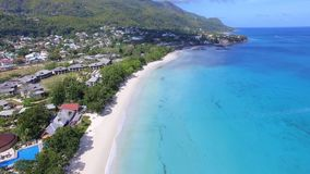 Beautiful aerial view of the beach, Indian Ocean And Mountains, Seychelles. Beautiful drone shot of the Beau Vallon Beach, Indian Ocean And Mountains, Seychelles stock video