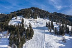 Beautiful drone view over the mountain of ski slope stock image