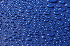 Beautiful drops on blue. Beautiful drops  on blue background Stock Photo