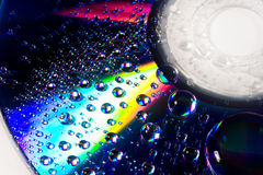 Beautiful drops of water. Closeup of drops of water (with beautiful reflections) on a multicolored surface Stock Photo