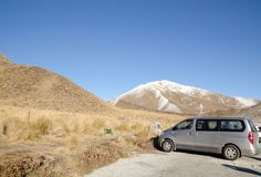 The Beautiful dry mountains with blue sky background near parking area at South Island, New Zealand. Stock Photos