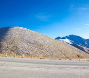 The Beautiful dry snowy mountains with blue sky background  at South Island, New Zealand. Stock Image