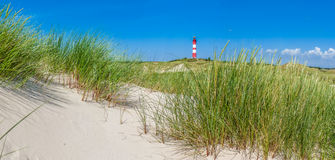 Beautiful dune landscape with traditional lighthouse at North Sea, Schleswig-Holstein, North Sea, Germany. Beautiful dune landscape with traditional lighthouse stock photo