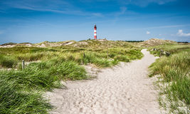 Beautiful dune landscape with traditional lighthouse at North Sea Royalty Free Stock Photography