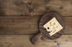 Beautiful Dutch cheese with holes, a healthy dairy product. Tasty food. Country style photo. Place for text. Copy space.  royalty free stock photography