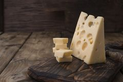 Beautiful Dutch cheese with holes, a healthy dairy product. Tasty food. Country style photo. Place for text. Copy space.  royalty free stock image