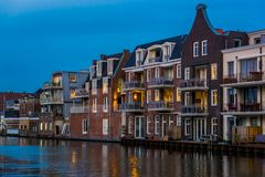Beautiful dutch city architecture by night, luxurious houses with balconies, Alphen aan den Rijn, The Netherlands stock photography