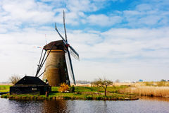 Beautiful dutch windmill house lands Royalty Free Stock Photography